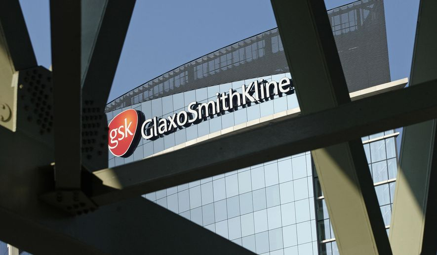 FILE - This April 20, 2009 file photo shows signage at the offices of pharmaceuticals firm GlaxoSmithKline, in London. GlaxoSmithKline on Wednesday, May 6, 2015 opted to keep its stake in its stand-alone HIV business as it set out its strategy following a big deal with Switzerland's Novartis. (AP Photo/Sang Tan, File)