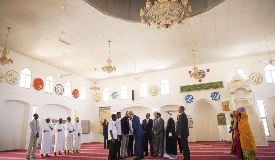 "U.S. Secretary of State John Kerry, centre, meets with youth at Salman Mosque in Dijbouti, Dijbouti, Wednesday, May 6, 2015.  Kerry said Wednesday he intends to discuss with Saudi Arabian officials how to implement a ""humanitarian pause"" in Yemen's civil war, citing increased shortages of food, fuel and medicine that are adding to a crisis that has already caused some thousands of people to flee to neighboring countries. (AP Photo/Andrew Harnik, Pool)"