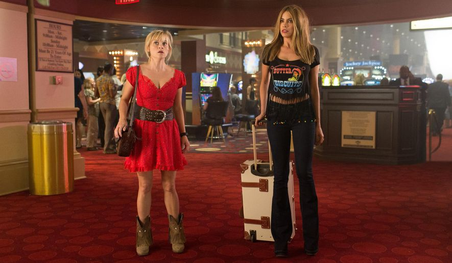 "In this image released by Warner Bros. Pictures, Reese Witherspoon, left, and Sofia Vergara appear in a scene from ""Hot Pursuit."" (Sam Emerson/Warner Bros. Pictures via AP)"