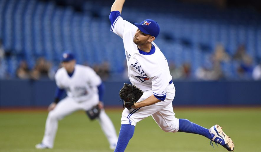 Toronto Blue Jays starting pitcher Marco Estrada throws against the New York Yankees during the first inning of a baseball game Tuesday, May 5, 2015, in Toronto. (AP Photo/The Canadian Press, Frank Gunn)