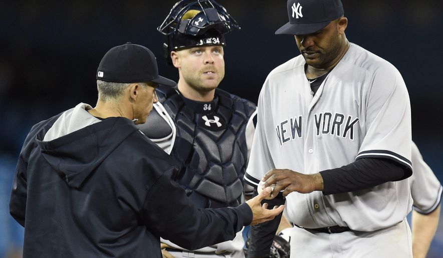 New York Yankees starting pitcher CC Sabathia hands the ball to manager Joe Girardi as he is pulled from the game against the Toronto Blue Jays as Yankees catcher Brian McCann looks on during seventh inning American League baseball action in Toronto, Wednesday, May 6, 2015.(Frank Gunn/The Canadian Press via AP) MANDATORY CREDIT