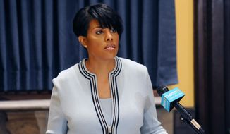 Mayor Stephanie Rawlings-Blake holds a news conference on Wednesday, May 6, 2015, in Baltimore.  The mayor called on U.S. government investigators to look into whether this city's beleaguered police department uses a pattern of excessive force or discriminatory policing. (Kim Hairston/The Baltimore Sun via AP)  WASHINGTON EXAMINER OUT