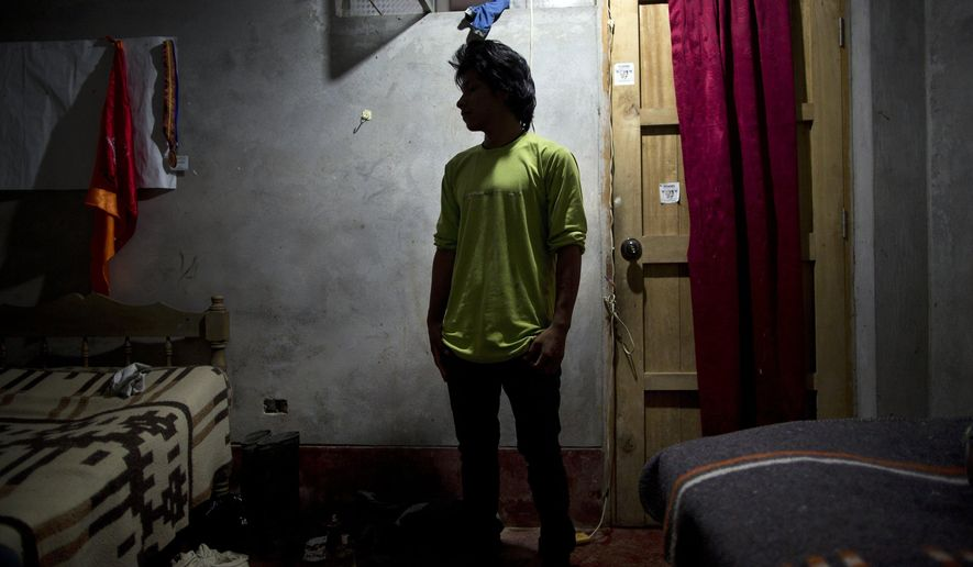 In this March 14, 2015 photo, Mardonio Borda,19, poses for a picture during an interview, in La Mar, province of Ayacucho, Peru. A native Quechua with broken Spanish and a sixth-grade education, Borda is among untold hundreds of cocaine backpackers who make the difficult and dangerous trek up Andean mountain paths first carved by their pre-Incan ancestors. (AP Photo/Rodrigo Abd)