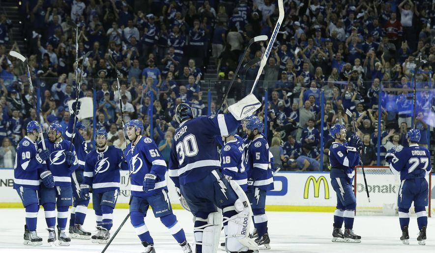 Tampa Bay Lightning players celebrate after they defeated the Montreal Canadiens 2-1 in Game 3 of an NHL second round playoff hockey match, Wednesday, May 6, 2015, in Tampa, Fla. (AP Photo/Wilfredo Lee)