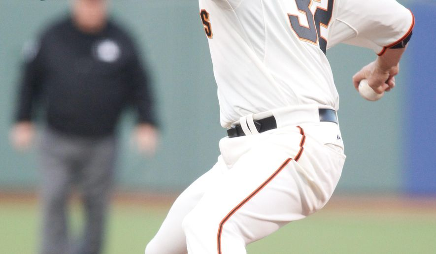 San Francisco Giants pitcher Ryan Vogelsong delivers against the San Diego Padres during the first inning of a baseball game Tuesday, May 5, 2015, in San Francisco. (AP Photo/Mathew Sumner)