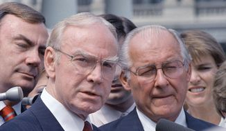 In this Aug. 5, 1987, file photo, then-House Speaker Jim Wright of Texas, left, and then-House Minority Leader Robert Michel of Illinois speak to reporters outside the White House in Washington. Wright, a veteran Texas congressman who was the first House speaker in history to driven out of office in midterm, has died. He was 92. (AP Photo/Barry Thumma, File)