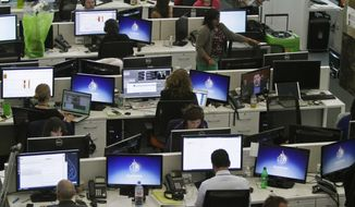 FILE - In this Aug. 20, 2013 file photo, Al-Jazeera America editorial newsroom staff prepare for their first broadcast in New York. The Al-Jazeera America news network ousted its chief executive on Wednesday, May 6, 2015, with the little-watched network suffering key defections and a lawsuit charging an employee with anti-Semitism. The network's management said that Ehab Al Shihabi, who has run Al-Jazeera America since its 2013 launch, will be replaced immediately by Al Anstey. A veteran news executive, Anstey has most recently been managing director of Al-Jazeera English. (AP Photo/Bebeto Matthews, File)