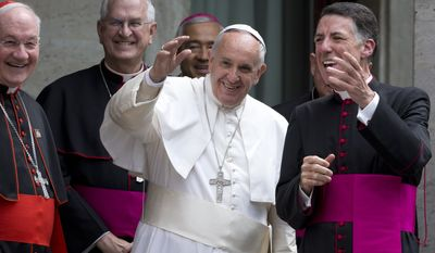 Pope Francis, flanked by rector of the Pontifical North American College James F. Checchio, right, Cardinal Marc Ouellet, left, and President of the United States Conference of Catholic Bishops Joseph Edward Kurtz, waves as he leaves Rome's Pontifical North American College on May 2, 2015. (Associated Press) ** FILE **