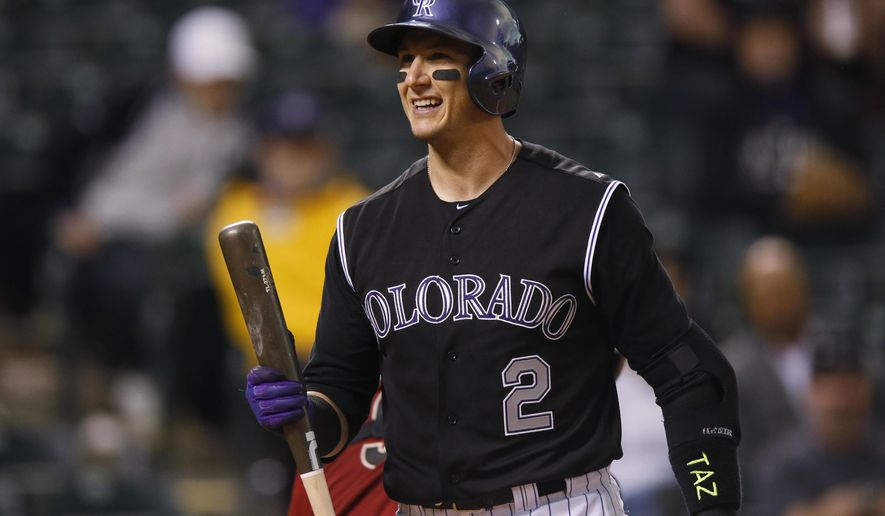 Colorado Rockies shortstop Troy Tulowitzki  reacts after striking out against Arizona Diamondbacks relief pitcher Addison Reed in the ninth inning of the second game of a baseball doubleheader Wednesday, May 6, 2015, in Denver. Arizona won 5-1 to take both ends of the doubleheader. (AP Photo/David Zalubowski)