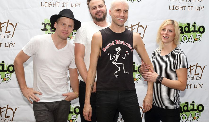 FILE - In this July 12, 2014 file photo, Chris Allen, from left, Branden Campbell, Tyler Glenn and Elaine Bradley of the band Neon Trees pose for photographers backstage at Festival Pier in Philadelphia. (Photo by Owen Sweeney/Invision/AP, File)