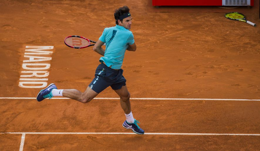 Roger Federer from Switzerland returns the ball during his Madrid Open tennis tournament match against Nick Kyrgios from Australia in Madrid, Spain, Wednesday, May 6, 2015. (AP Photo/Andres Kudacki)