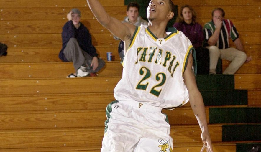 FILE - In this Jan. 3, 2003 file photo, Elton Simpson goes uncontested for a layup during a Yavapai College basketball game in Prescott, Ariz. Simpson was one of the two gunmen who was shot and killed by authorities outside a suburban Dallas venue Sunday, May 3, 2015 which was hosting a contest for Muslim Prophet Muhammad cartoons. The gunmen, whom federal officials identified as Simpson and Nadir Soofi, wounded a security officer before they were shot and killed at the scene. (Les Stukenberg/The Daily Courier via AP) MANDATORY CREDIT: LES STUKENBERG/THE DAILY COURIER