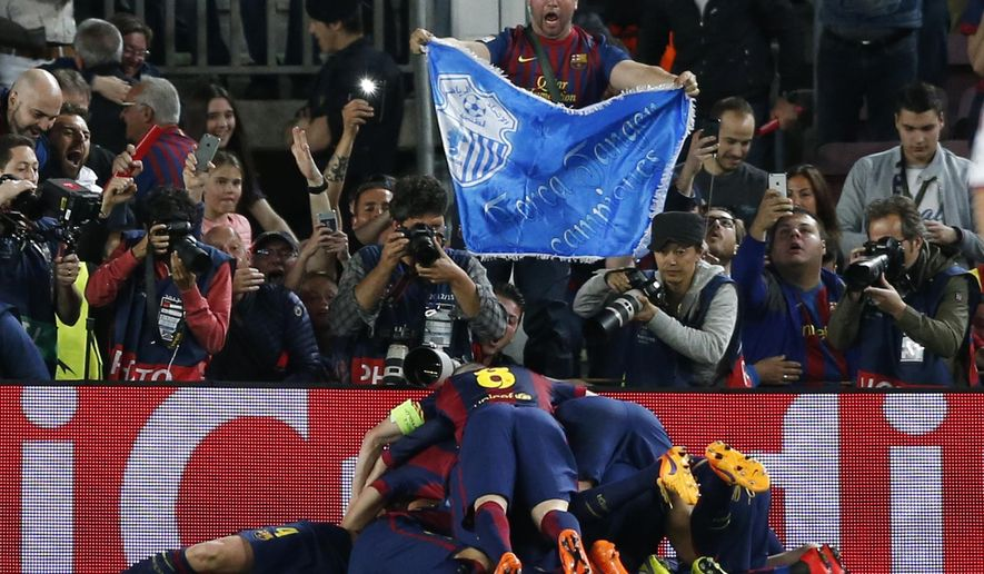 Barcelona players celebrate after scoring their second goal during the Champions League semifinal first leg soccer match between Barcelona and Bayern Munich at the Camp Nou stadium in Barcelona, Spain, Wednesday, May 6, 2015.  (AP Photo/Manu Fernandez)