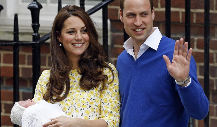 FILE - In this  Saturday, May 2, 2015. file photo, Kate Duchess of Cambridge and Prince William smile as they carry their newborn baby princess  from The Lindo Wing of St. Mary's Hospital, in London  Britain's newborn princess has been named Charlotte Elizabeth Diana it was announced on Monday May 4. (AP Photo/Kirsty Wigglesworth, File)