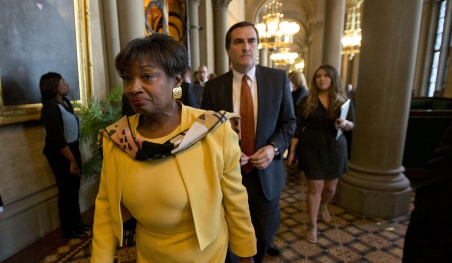 Senate Democratic Conference Leader Andrea Stewart-Cousins, D-Yonkers, followed by Sen. Michael Gianaris, D-Queens, walk out of a legislative session in the Senate Chamber at the Capitol on Wednesday, May 6, 2015, in Albany, N.Y. Democratic lawmakers walked out of the Senate in protest Wednesday after Republicans refused to allow the vote to remove Dean Skelos as Senate majority leader. (AP Photo/Mike Groll)
