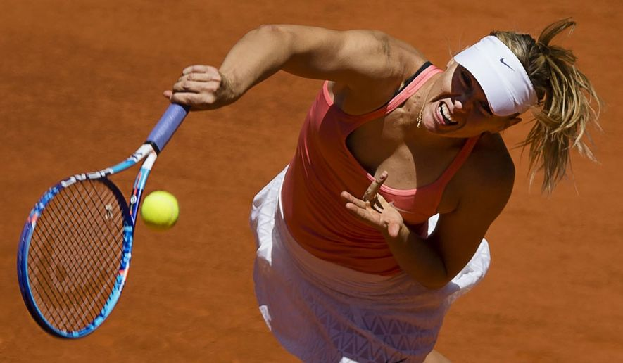 Maria Sharapova from Russia serves during her Madrid Open tennis tournament match against Caroline Garcia from France in Madrid, Spain, Wednesday, May 6, 2015. (AP Photo/Daniel Ochoa de Olza)