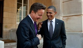 President Barack Obama talks with British Prime Minister David Cameron following their joint press conference at Lancaster House in London, England, May 25, 2011. (Official White House Photo by Pete Souza)
