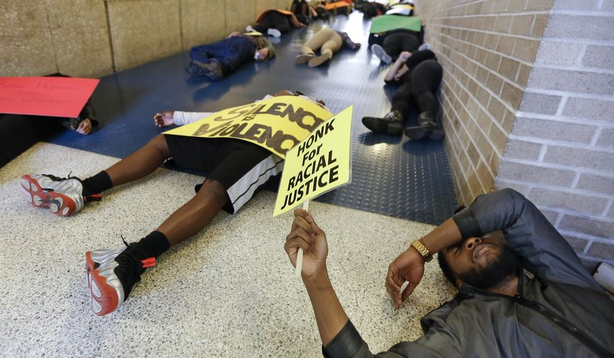 "University of Toledo senior Lance Price, president of the Black Student Union, joins others during a ""die in"" on campus Tuesday, May 5,  2015, in Toledo, Ohio. An organizer of the protest said the event was aimed at raising general awareness of what he called institutional racism in the criminal justice system and at universities. (Andy Morrison/The Blade via AP)  MANDATORY CREDIT; MAGS OUT; NO SALES; TV OUT; SENTINEL-TRIBUNE OUT; MONROE EVENING NEWS OUT; TOLEDO FREE PRESS OUT"