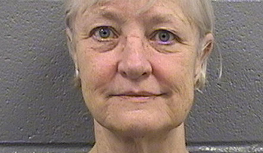 This undated booking photo provided by the Cook County Sheriff's Department shows 63-year-old Marilyn Hartman. Hartman was arrested Friday, April 24, 2015, for loitering in a restricted area at O'Hare International Airport in Chicago. She was charged with misdemeanor criminal trespassing on state land and released. She was arrested again in Chicago on Sunday May 3, at Midway International Airport and charged with the same offense in addition to violating her bail bond. Hartman has succeeded in getting on a flight at least once without a ticket. She has previously said she's mentally ill and homeless. (Cook County Sheriff's Department via AP)