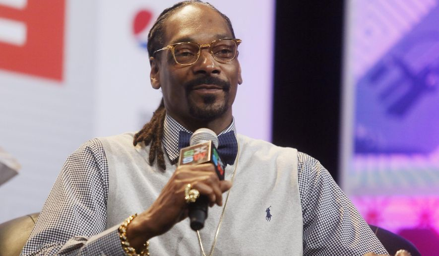 "FILE - In this March 20, 2015 file photo, rapper Snoop Dogg takes part in the ""Keynote Conversation with Snoop Dogg"" at the South by Southwest festival in Austin, Texas. Texas' chief law enforcement official called Snoop Dogg a ""dope smoking cop hater"" before reprimanding a state trooper who posed for a picture with the rapper, according to emails made public Wednesday, May 6, 2015. (Jack Plunkett/Invision via AP, File)"