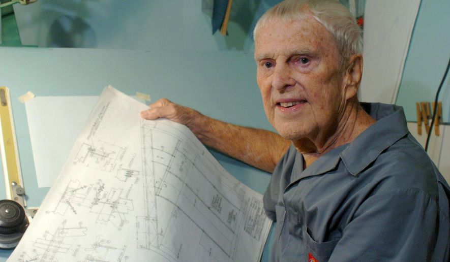 "In this photo taken Sept. 2, 2008, engineer Oscar Carl Holderer, one of Wernher von Braun's original ""Operation Paperclip"" team members, holds some technical drawings in his home shop behind his house in Huntsville, Ala. Holderer, the last known surviving member of the German engineering team that came to the United States after World War II and designed the rocket that took astronauts to the moon, died Tuesday, May 5, 2015 in Huntsville, Ala. He was 95. (Eric Schultz/AL.com via AP)MANDATORY CREDIT"