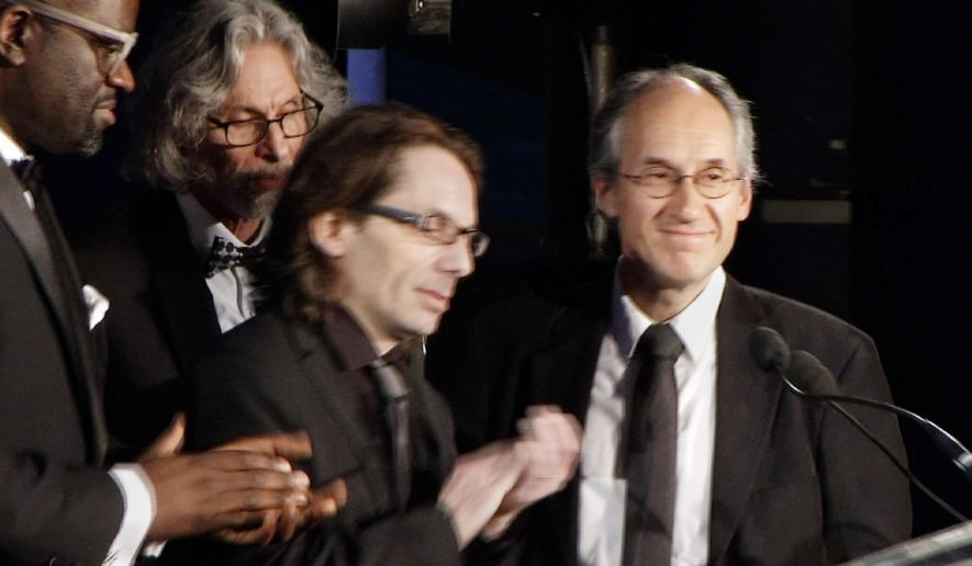 In this Tuesday, May 5, 2015 image from video, Gerard Biard, right, Editor-in-Chief of Charlie Hebdo, and Jean-Baptiste Thoret, second from right, the French magazine's film critic, accept the Freedom of Expression Courage Award from the PEN American Center in a ceremony at the American Museum of Natural History in New York. In accepting the award, Biard noted the magazine's history of shocking readers with its irreverent drawings of religious figures. (AP Photo)