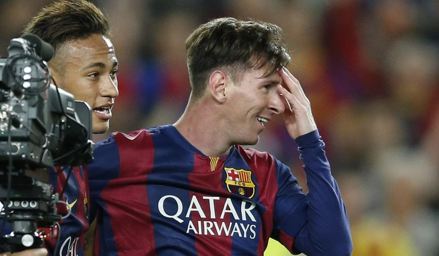 Barcelona's Neymar, left, and Lionel Messi celebrate after winning 3-0 in the Champions League semifinal first leg soccer match between Barcelona and Bayern Munich at the Camp Nou stadium in Barcelona, Spain, Wednesday, May 6, 2015.  (AP Photo/Manu Fernandez)