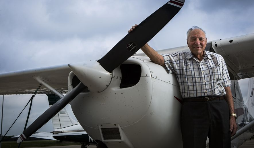 Jacob Jack Dorshaw, 96, is photographed in front of his plane on April 24, 2015 in Sugar Land, Texas.  Dorshaw has been flying aircrafts since the 1940s and today he considers flying his greatest pleasure.  (Marie D. De Jesus/Houston Chronicle via AP)