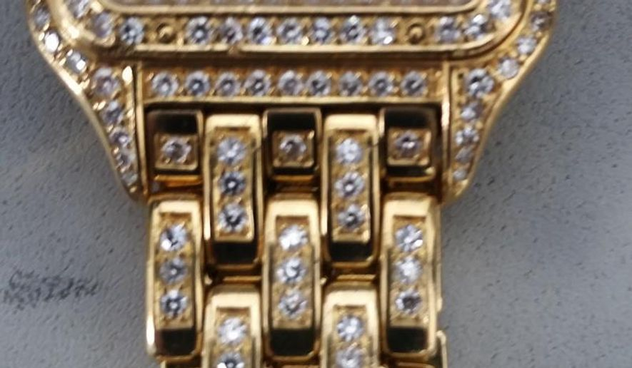 This May 5, 2015 photo provided by the Transportation Security Administration shows a  diamond-encrusted Cartier watch that was left behind at a security checkpoint at Newark Liberty International Airport in Newark, N.J. Guards got a surprise when they looked in a bin and discovered the watch valued at more than $100,000 when a real estate entrepreneur from Japan left it behind as he boarded a flight back home in Terminal C on Tuesday, May 5. A Transportation Security Administration officer put the watch under lock and key. (Transportation Security Administration via AP)