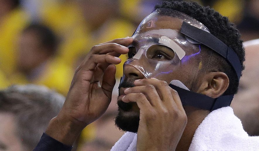 FILE - In this May 5, 2015, file photo, Memphis Grizzlies guard Mike Conley adjusts his mask during the first half of Game 2 in a second-round NBA playoff basketball series against the Golden State Warriors in Oakland, Calif. Conley's gritty comeback got the Memphis Grizzlies on track and stole home-court advantage away from the Golen State Warriors in their Western Conference series. (AP Photo/Ben Margot, File)