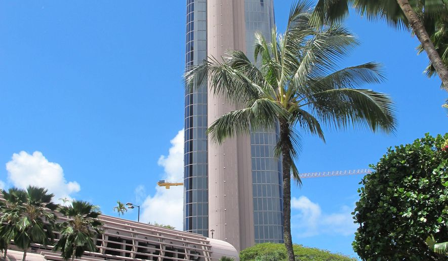 This photo shows the One Waterfront Towers apartment complex Thursday, May 7, 2015, in Honolulu. Three men were sentenced to prison terms ranging from five to 15 years for a case involving 3 pounds of crystal meth thrown from a 15th floor balcony of one of the apartments in the complex. (AP Photo/Jennifer Sinco Kelleher)