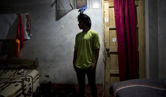 Mardonio Borda, 19, poses for a picture during an interview, in La Mar, province of Ayacucho, Peru, in this March 14, 2015, file photo. A native Quechua with broken Spanish and a sixth-grade education, Borda is among untold hundreds of cocaine backpackers who make the difficult and dangerous trek up Andean mountain paths first carved by their pre-Incan ancestors. (AP Photo/Rodrigo Abd)