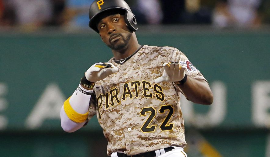 Pittsburgh Pirates' Andrew McCutchen (22) celebrates as he stands on second base after driving in a run with a double off Cincinnati Reds starting pitcher Anthony DeSclafani in the fifth inning of a baseball game in Pittsburgh, Thursday, May 7, 2015. (AP Photo/Gene J. Puskar)