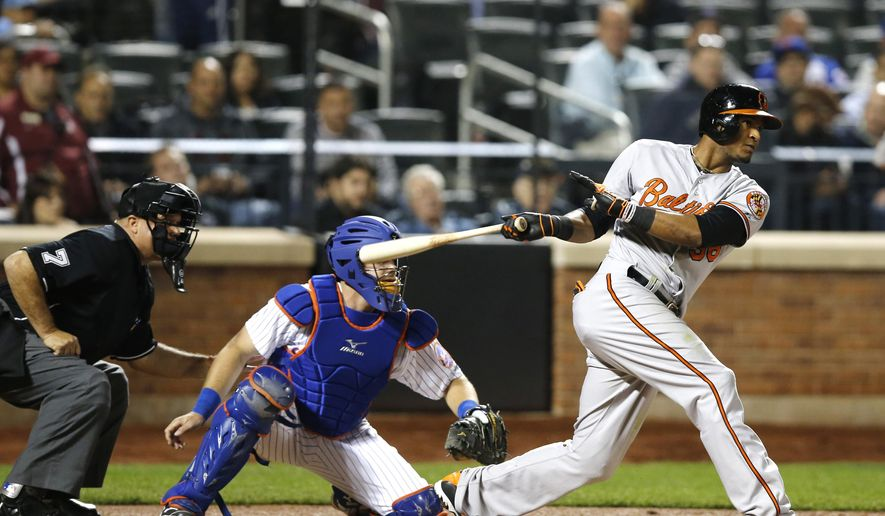 Baltimore Orioles' Jimmy Paredes hits an RBI single in the fifth inning of a baseball game against the New York Mets, Wednesday, May 6, 2015, in New York. Travis Snider scored on the play. (AP Photo/Kathy Willens)