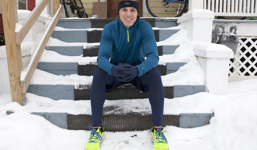 "In this Jan. 2, 2014 photo, Barclay Oudersluys sits on the porch of his home in Ann Arbor, Mich. Oudersluys is planning a coast-to-coast run over 100 days that's similar to part of one taken by Tom Hanks' character in the movie ""Forrest Gump."" He plans to start the 3,200-mile run he's calling ""Project Gump"" on Saturday, May 9, 2015 from California's Santa Monica Pier en route to Marshall Point Lighthouse in Maine.  Oudersluys wants to raise $10,000 for the nonprofit Hall STEPS Foundation, which aims to fight global poverty.  (Patrick Record/The Ann Arbor News via AP) LOCAL TELEVISION OUT; LOCAL INTERNET OUT"