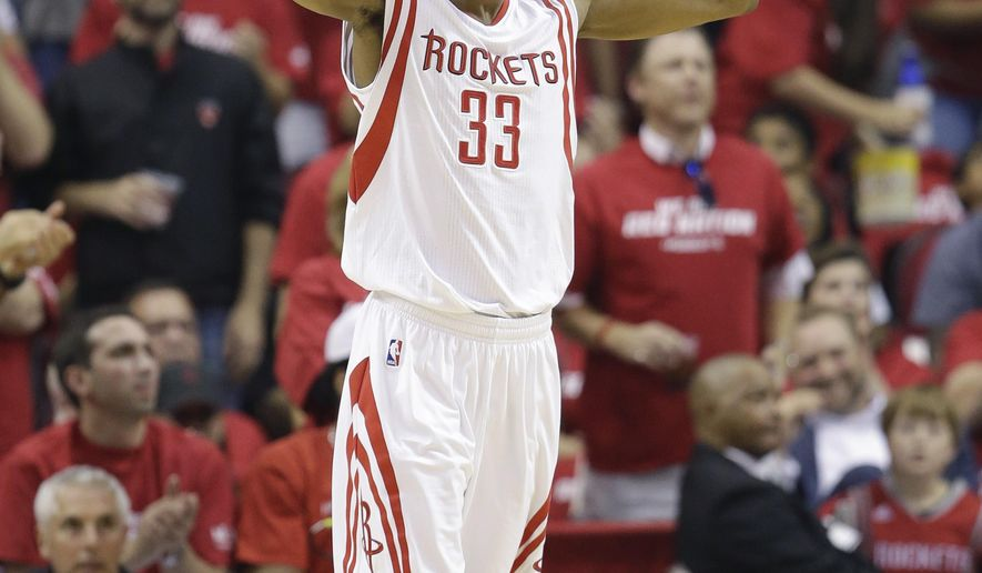 Houston Rockets' Corey Brewer (33) signals to the crowd during the first half of Game 2 in a second-round NBA basketball playoff series against the Los Angeles Clippers, Wednesday, May 6, 2015, in Houston. (AP Photo/David J. Phillip)