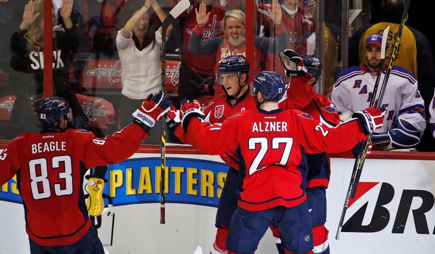 Capitals center Jay Beagle and defenseman Karl Alzner celebrate Andre Burakovsky's game-winning goal in the third period of Game 4 Wednesday. (Associated Press)
