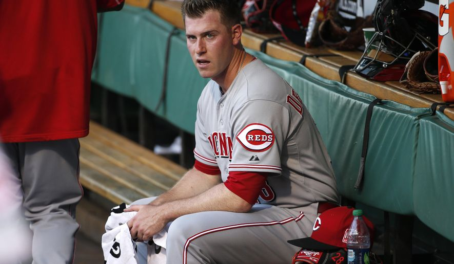 Cincinnati Reds starting pitcher Anthony DeSclafani sits in the dugout after warming up before a baseball game against the Pittsburgh Pirates, Thursday, May 7, 2015, in Pittsburgh. (AP Photo/Gene J. Puskar)