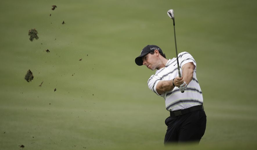 Rory McIlroy hits a shot on the second fairway during a practice round for The Players Championship golf tournament, Wednesday, May 6, 2015, in Ponte Vedra Beach, Fla. (AP Photo/John Raoux)
