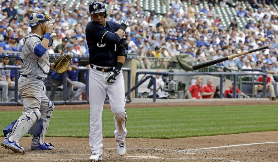 Milwaukee Brewers' Aramis Ramirez tosses his bat after striking out during the sixth inning of a baseball game against the Los Angeles Dodgers Thursday, May 7, 2015, in Milwaukee. (AP Photo/Morry Gash)