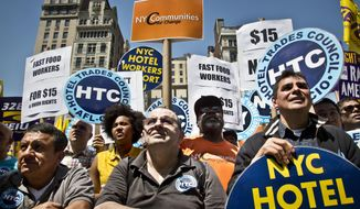 Labor union members and supporters listen during a rally as Gov. Andrew Cuomo announces a plan to get a minimum  $15 an hour wage hike for fast-food workers, Thursday, May 7, 2015, in New York. Cuomo is proposing a plan to get a minimum wage hike that doesn't require legislative approval. Cuomo said he will direct the state labor commissioner to examine the minimum wage in the fast-food industry. (AP Photo/Bebeto Matthews)