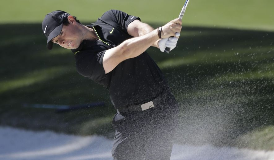 Rory McIlroy, of Northern Ireland, hits from the sand on the 15th hole fairway during the first round of The Players Championship golf tournament Thursday, May 7, 2015, in Ponte Vedra Beach, Fla.  (AP Photo/John Raoux)