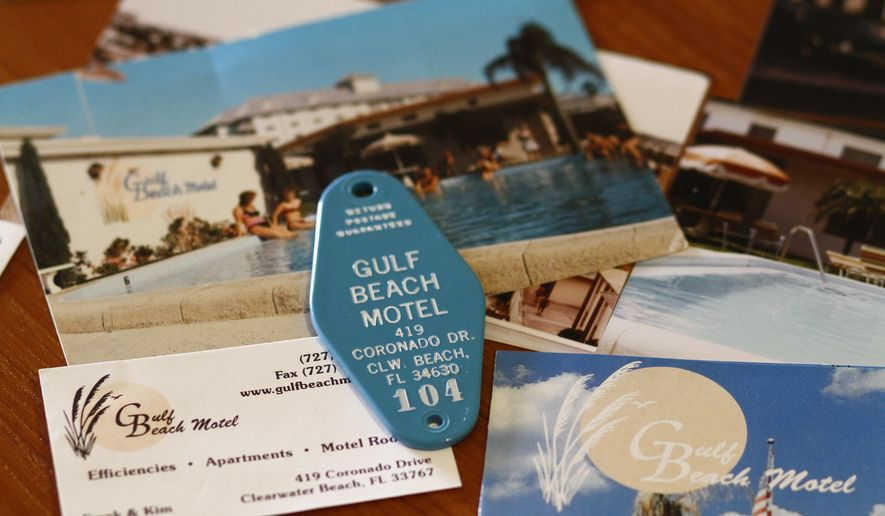 "ADVANCE FOR USE SUNDAY, MAY 10, 2015, AND THEREAFTER- In this April 30, 2015, photo, an old brochure and a hotel room key fob for the Gulf Beach Motel where it is rumored to be the birth place of the iconic song ""Satisfaction"" is displayed in Cathy Kingsley's home in Bradenton, Fla. Kingsley has been to 50 Rolling Stones concerts all over the world, and owns a minimuseum of Rolling Stones memorabilia. She has read all the books. And on at least a half-dozen occasions, she has come from her home in Bradenton to Clearwater, usually with fellow fans in tow, to pay homage to the place Satisfaction was born. (Luis Santana/The Tampa Bay Times via AP)  TAMPA OUT; CITRUS COUNTY OUT; PORT CHARLOTTE OUT; BROOKSVILLE HERNANDO TODAY OUT"