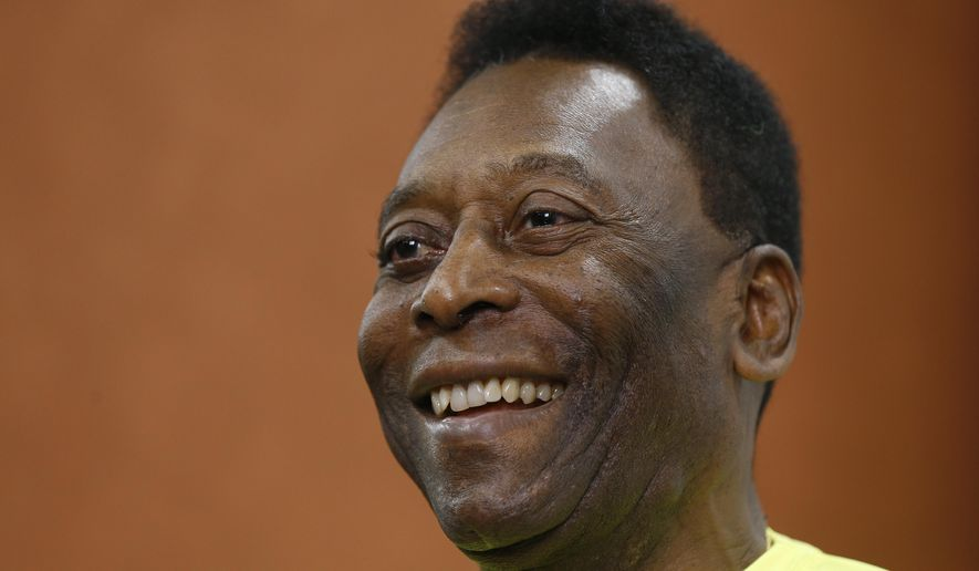 "FILE - In this March 20, 2015, file photo, Brazilian soccer legend Pele smiles during a media opportunity at a restaurant in London. The 74-year-old football great was in a ""stable"" condition after surgery this week, the Albert Einstein Hospital said in a statement on Thursday, May 7, 2015. (AP Photo/Kirsty Wigglesworth,File)"