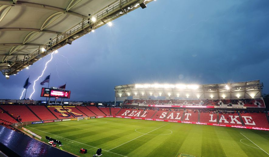 Lightning strikes as the game between Real Salt Lake and the LA Galaxy is delayed Wednesday, May 6, 2015, due to severe weather in the area at Rio Tinto Stadium in Sandy Utah. (/The Deseret News via AP)  SALT LAKE TRIBUNE OUT;  MAGS OUT