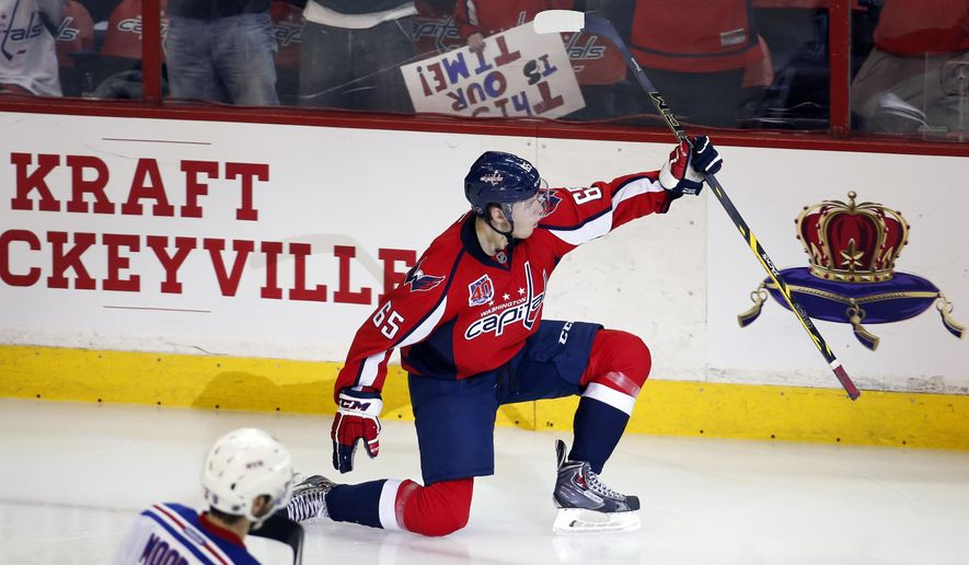 Washington Capitals left wing Andre Burakovsky (65), from Austria, celebrates his game winning goal during the third period of Game 4 in the second round of the NHL Stanley Cup hockey playoffs against the New York Rangers, Wednesday, May 6, 2015, in Washington. The Capitals won 2-1. (AP Photo/Alex Brandon)