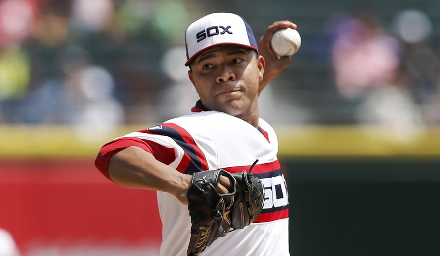 Chicago White Sox starting pitcher Jose Quintana delivers during the first inning of a baseball game against the Detroit Tigers Thursday, May 7, 2015, in Chicago. (AP Photo/Charles Rex Arbogast)