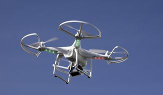 A drone flies at the International Consumer Electronics Show in Las Vegas, Jan. 8, 2014. (Associated Press) ** FILE **
