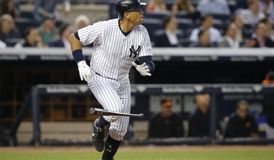 New York Yankees designated hitter Alex Rodriguez reacts after hitting his 661st home run, surpassing Willie Mays for fourth all-time, in a baseball game against the Baltimore Orioles at Yankee Stadium in New York, Thursday, May 7, 2015.  (AP Photo/Kathy Willens)