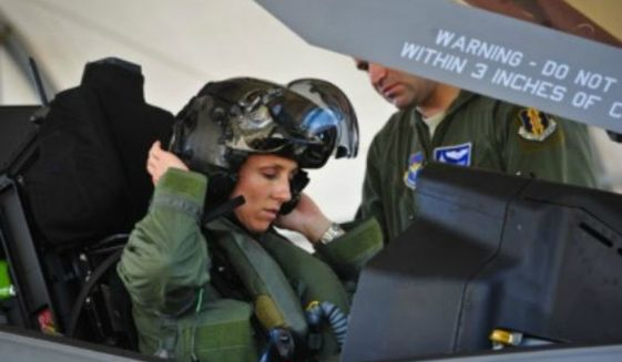 Lt. Col. Christine Mau, 33rd Operations Group deputy commander, readies for flight in an F-35A aircraft. (Image: U.S. Air Force) ** FILE **